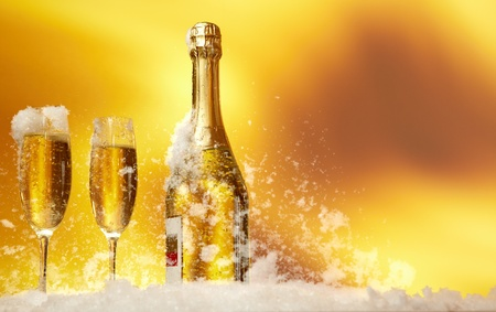 gold flute: New Year champagne in the  snow