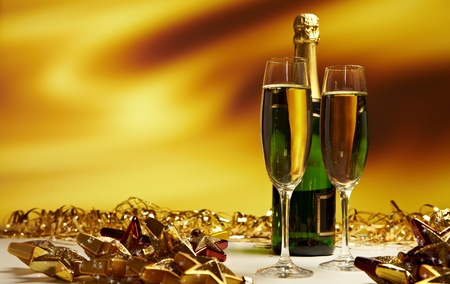 Glass of champagne against golden background  photo