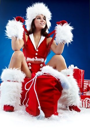cloath: Portrait of beautiful sexy girl wearing santa claus clothes