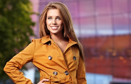 beautiful young  woman in autumn city photo