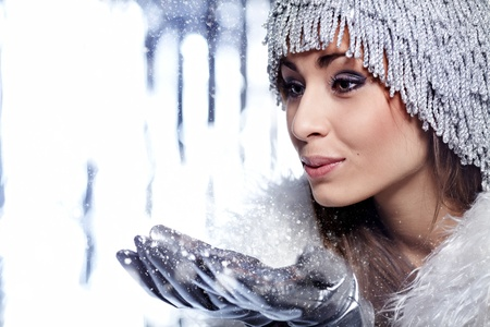 frost: Christmas Girl.Winter woman Blowing Snow  Stock Photo