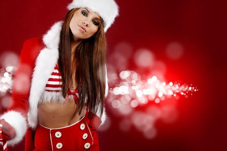 20-25 years olf beautiful woman in christmas dress  Stock Photo - 10835190