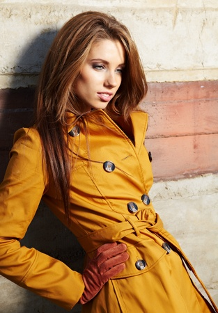 autumn in the city: young brunette woman portrait in autumn color