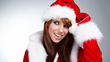 Beautiful Young Happy Christmas Woman over white Stock Photo - 10835180
