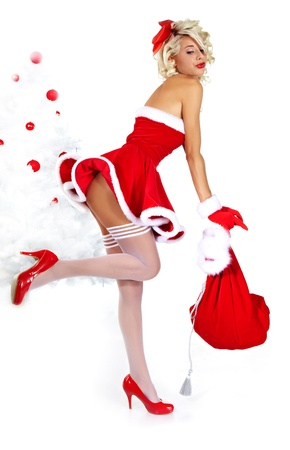 sexy santa girl: Pin-up sexy girl wearing santa claus clothes  Stock Photo