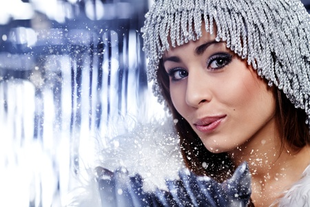 Christmas Girl.Winter woman Blowing Snow  photo