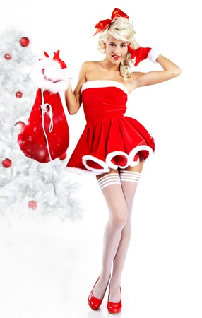 Pin-up sexy girl wearing santa claus clothes  Stock Photo