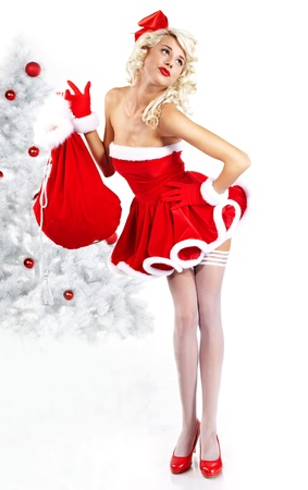 Pin-up sexy girl wearing santa claus clothes  Stock Photo - 10967205