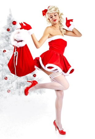 Pin-up sexy girl wearing santa claus clothes Stock Photo - 10967202