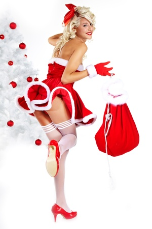 red pin: Pin-up sexy girl wearing santa claus clothes  Stock Photo