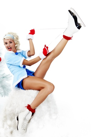 Smiling pinup woman carrying a pair of ice skates Stock Photo - 10967192