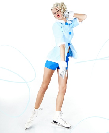 Smiling pinup woman carrying a pair of ice skates  photo