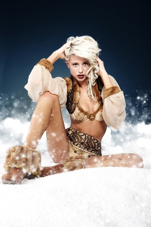 Winter wild woman on snow Stock Photo - 10967244