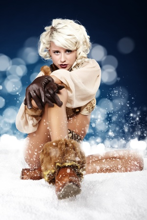 Winter wild woman on snow Stock Photo - 10967246