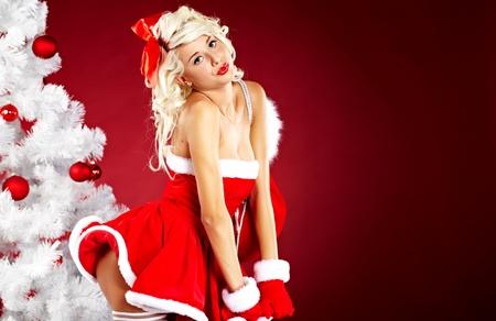 beautiful sexy girl wearing santa claus clothes  photo
