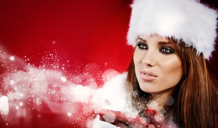 Portrait of beautiful sexy girl wearing santa claus clothes  photo