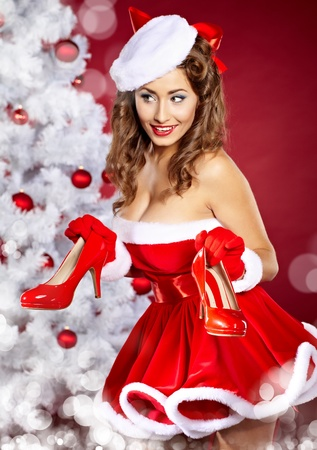 christmas Woman getting shoes as gift.  photo