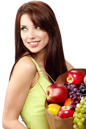 Smiling woman with fruits and vegetables. Over white background photo