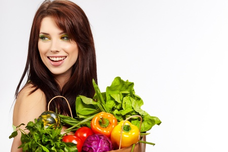 Smiling woman with fruits and vegetables. Over white background Stock Photo - 11064996