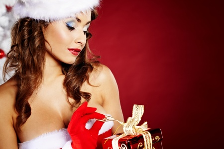 sexy santa girl: Portrait of beautiful sexy girl wearing santa claus clothes on red background