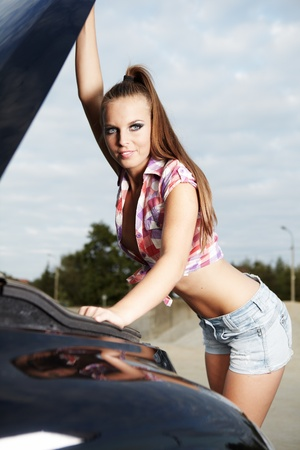 young sexy woman with her broken car.