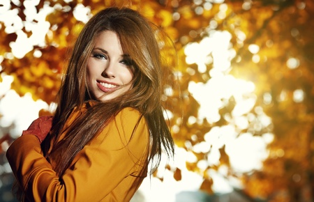 young brunette woman portrait in autumn field  Stock Photo - 11148430