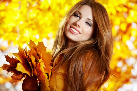 autumn young: Young pretty woman at the autumn park.
