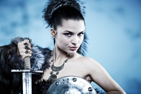 woman with sword: Warrior woman. Fantasy fashion idea.  Stock Photo