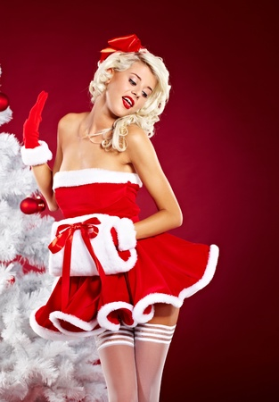 cloath: Pin-up sexy girl wearing santa claus clothes  Stock Photo