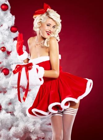 Pin-up sexy girl wearing santa claus clothes Stock Photo - 11292095
