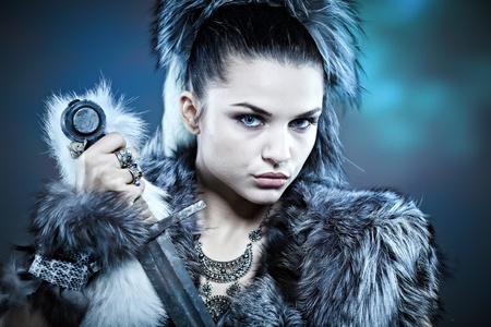 female warrior: Warrior woman. Fantasy fashion idea.  Stock Photo