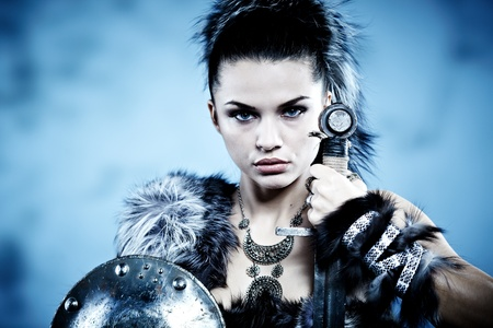 traditional weapon: Warrior woman. Fantasy fashion idea.  Stock Photo