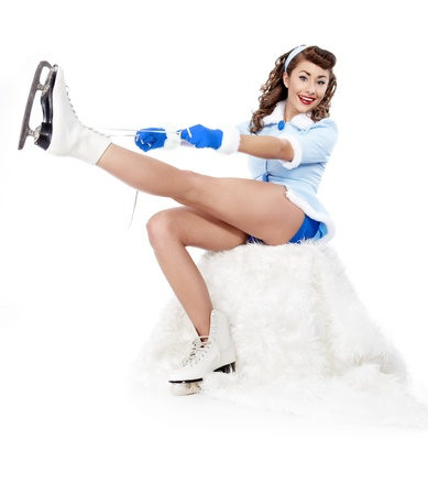 beautiful young pin-up woman going to ice skating  photo