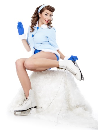 beautiful young pin-up woman going to ice skating Stock Photo - 11292720