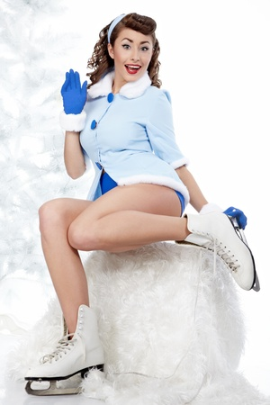 beautiful young pin-up woman going to ice skating Stock Photo - 11292743