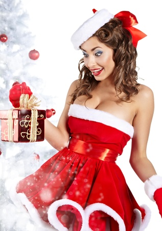 sexy costume: Fashionable young woman in Santa Claus clothes with presents