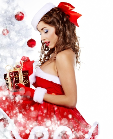 Fashionable young woman in Santa Claus clothes with presents Stock Photo - 11292735