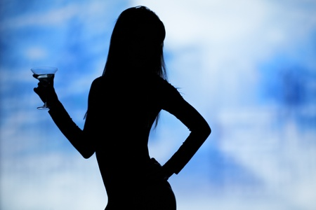 dancing silhouettes of women with champagne in a nightclub  photo