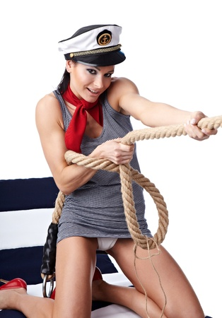 captain: 20-25 years old beautiful woman wearing sailor hat Stock Photo