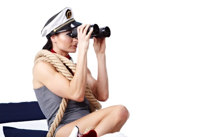 sailor girl: Woman looking through binoculars isolated on white