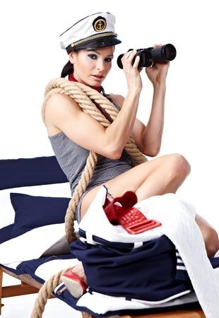 Woman looking through binoculars isolated on white photo