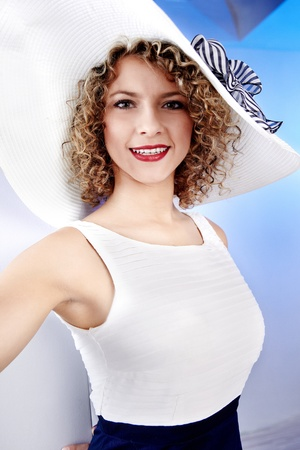 Summer woman wearing white hat photo