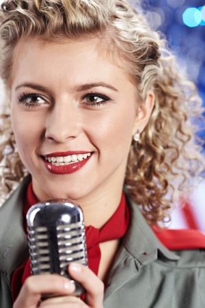 feminine beauty: Beautiful sexy army woman singing Stock Photo