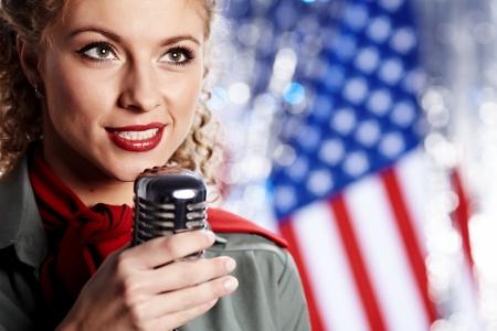 Beautiful sexy army woman singing photo