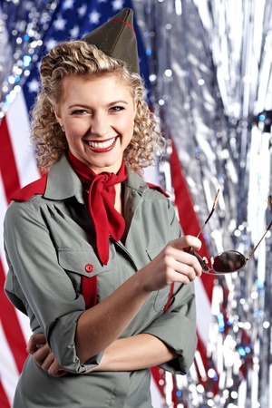 army girl: Pin-up army woman  standing near the American flag