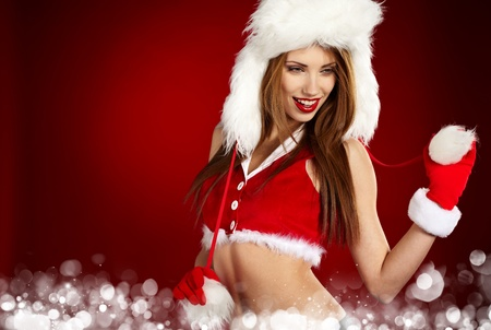 christmas girl: Portrait of beautiful sexy girl wearing santa claus clothes