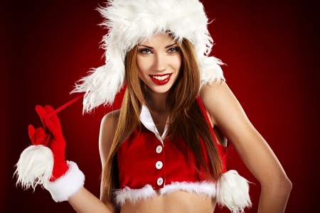 santa girl: Portrait of beautiful sexy girl wearing santa claus clothes