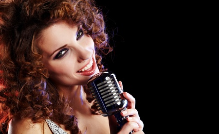 karaoke singer: Portrait of a glamorous girl with mike singing song