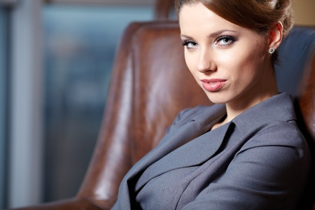 Young sexy  business woman in modern office.  photo