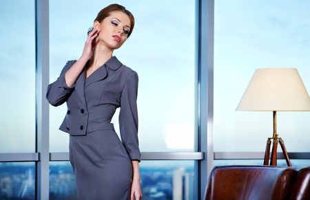 Business woman in an office environment with large stained-glass window on background  photo